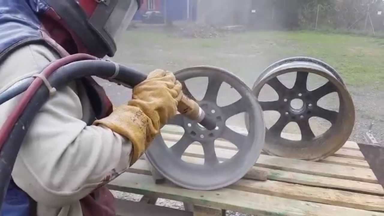 Alloy wheel refurbishment, sand blasting wheels